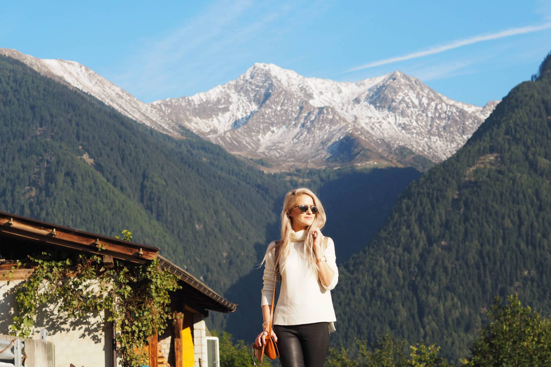 white hair inthefrow in south tyrol, north italy in revolve clothing and Maje suede jacket