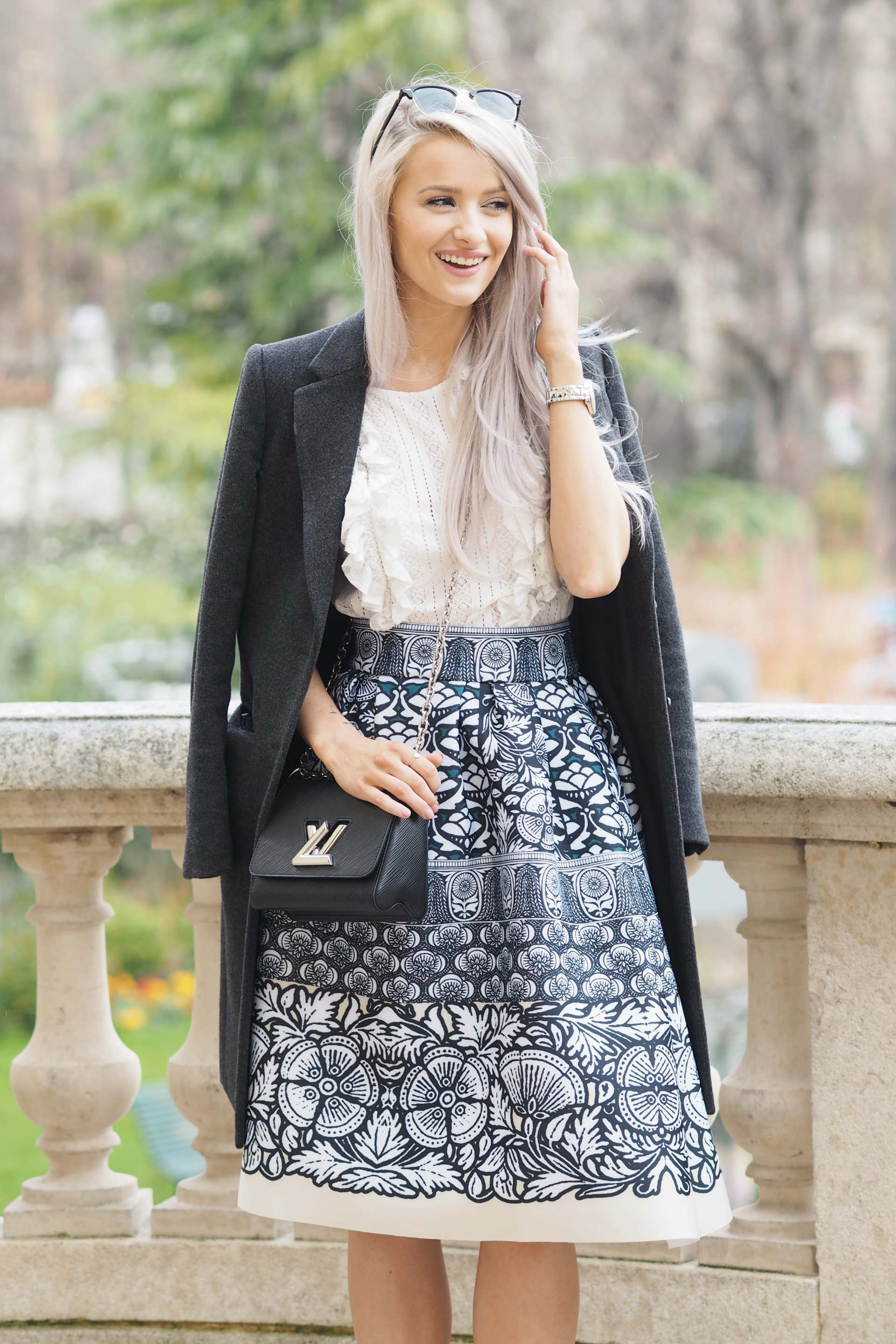 inthefrow paris fashion week in maje and louis vuitton and gianvito rossi caged ankle heels