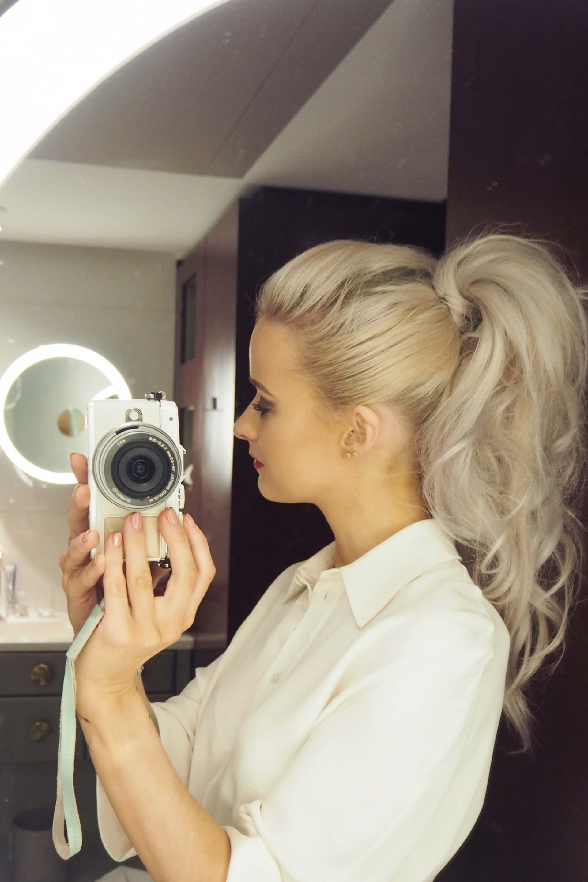 inthefrow white hair curly high ponytail