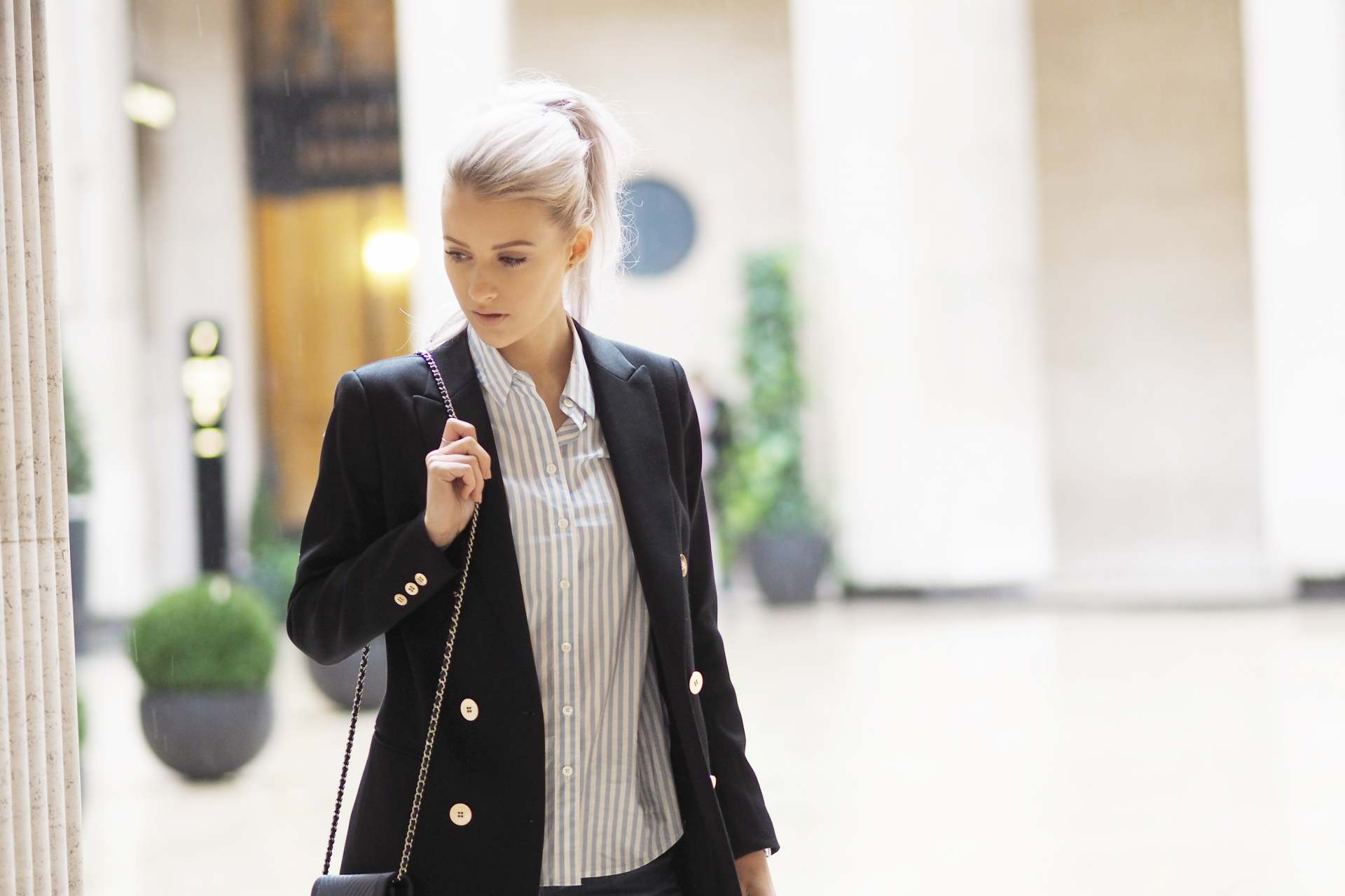 inthefrow white hair curly high ponytail eiss lavinia blazer and valentino rockstud, chanel woc, equipment shirt