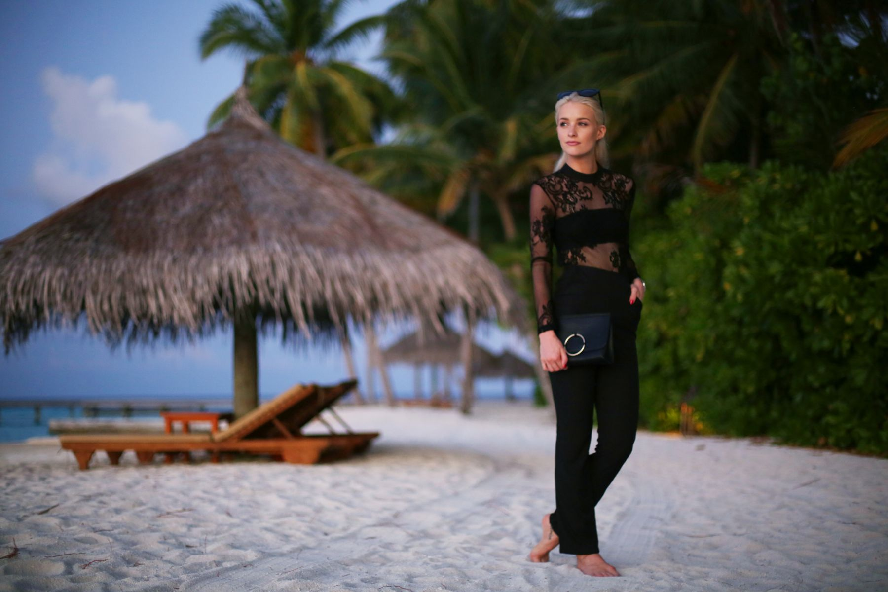 holiday evening outfits / black lacy glamorous jumpsuit / inthefrow
