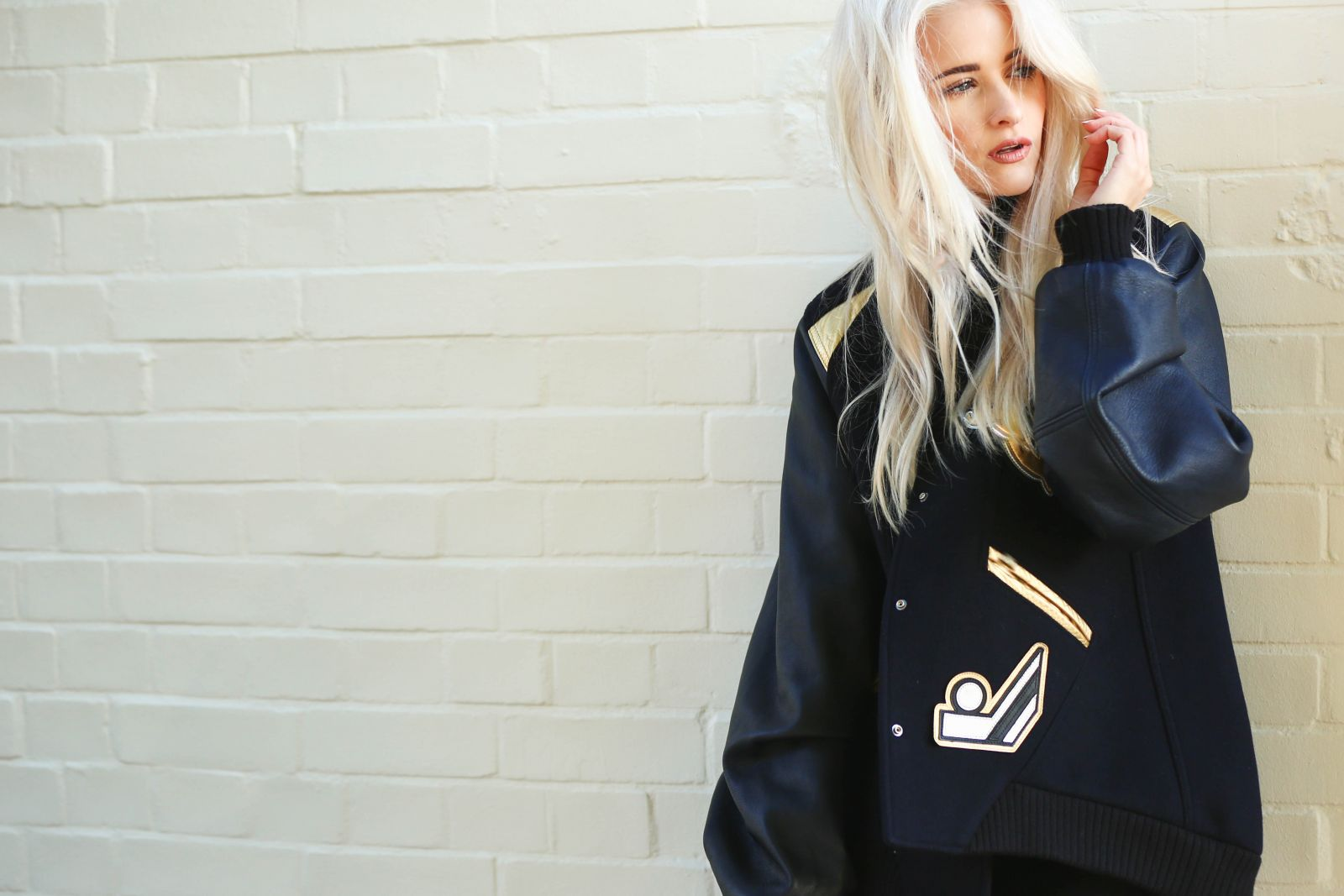 How to style the varsity jacket for fall to winter inthefrow whilst the accessories are metallic studded flashy and something out of the 50s rock n roll era mixed with a splash of vegas buycottarizona